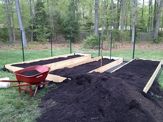 Bringing in rich soil to support the growth of vegetables throughout the season.