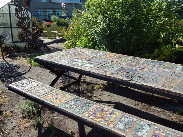 Kids young and old contributed to this tile mosaic table design.