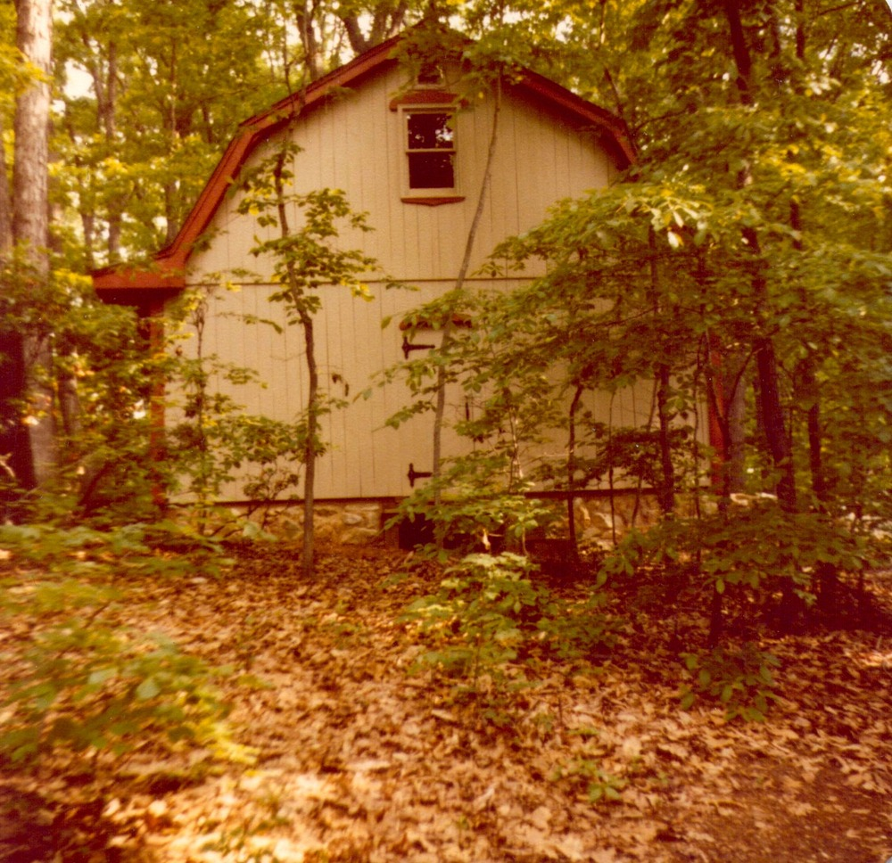 Hank built the barn in his backyard by himself with some help from friends, designing it and even learning how to  lay a stone foundation. The barn was later painted an outrageous shade of green. Circa early 1980s.