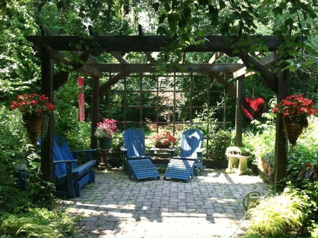 The arbor provides a tranquil place to relax in the Mays Garden in Ohio.