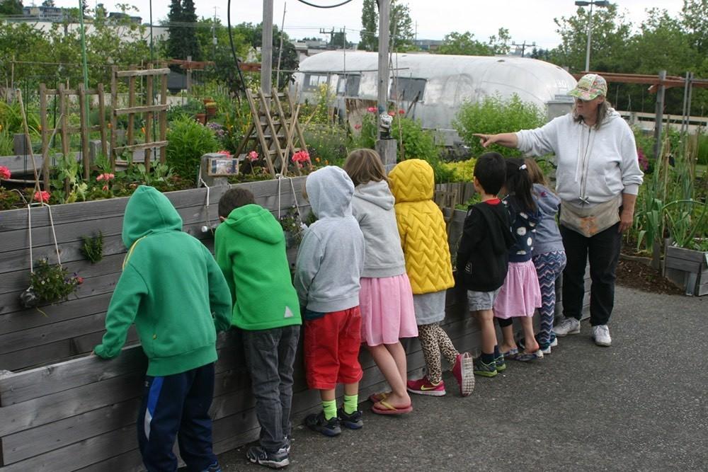 Bonnie teaching children in the garden