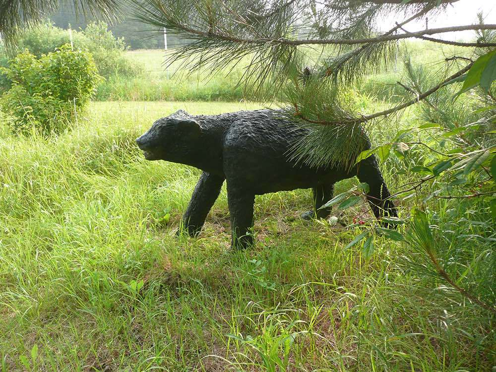 A bear sculpture in the garden