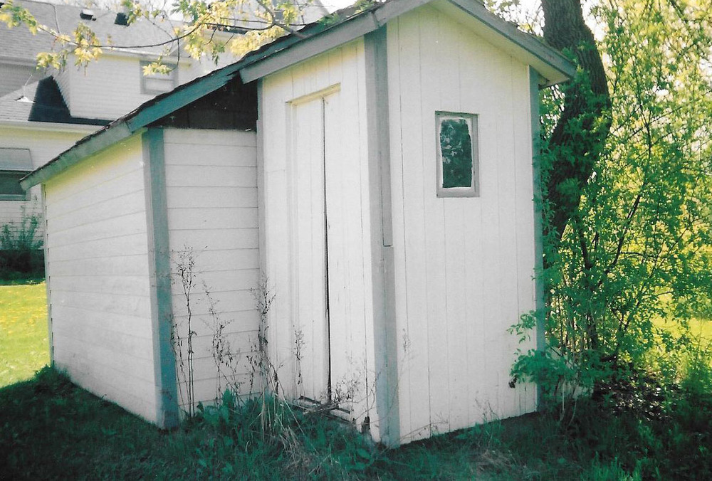 Barg Family Homestead outhouse with playhouse.