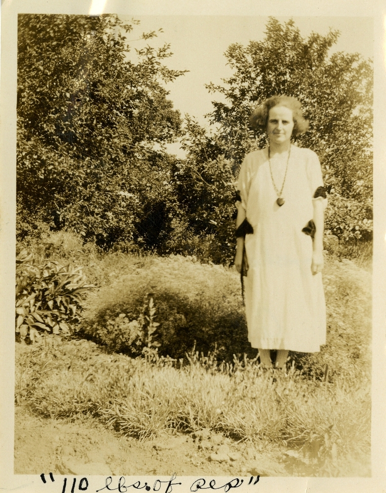 """110 lbs. of pep."" Cecilia Auge in her onion garden in  Mendota, Minnesota, circa 1924. Smithsonian Institution, Archives of American Gardens, W. Atlee Burpee & Company Records."