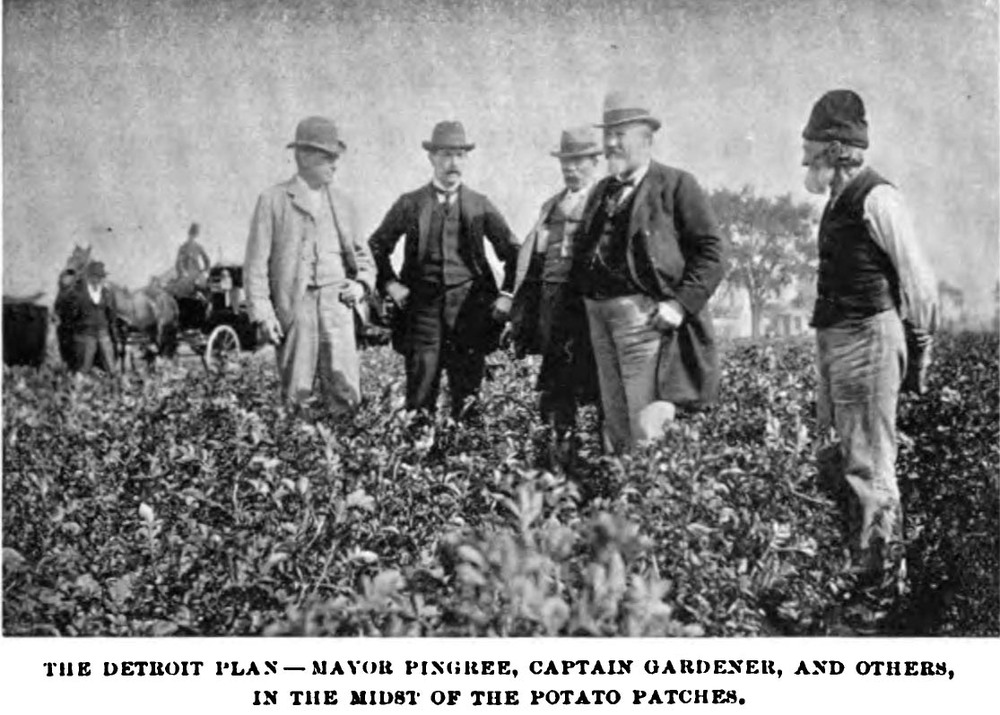 Mayor Pingree (fourth from left) and members of the Agricultural Committee visit one of the Potato Patches as a gardener looks on (right). <em>The Arena Magazine</em>, 1896.