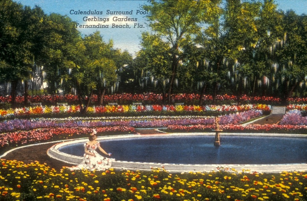 Colorized photo postcard depicting the sunken pool and fountain, framed in marigolds and azaleas, circa 1945-1947. Smithsonian Institution, Archives of American Gardens, Garden Club of America Collection.