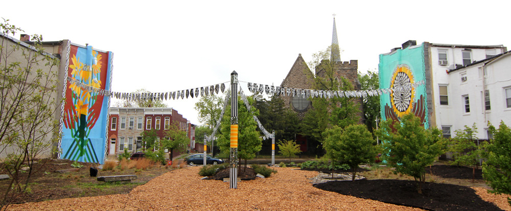 A panoramic view of the Sunflower Village. In 2010 it was transformed from just another abandoned lot into a beautiful community garden and meeting space.