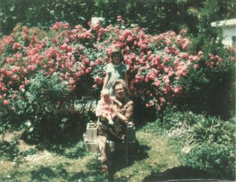 The author, her sister, and grandmother in the rose garden, 1981.