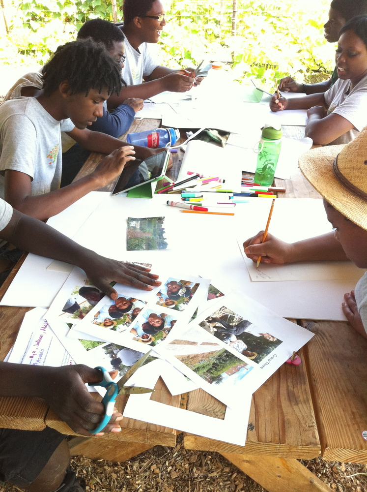 The summer youth program participants edit their photographs and stories about Common Good City Farm for final presentations, July 2013.