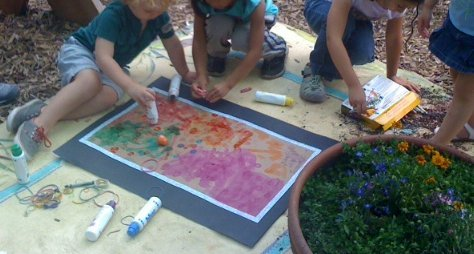 Children creating a mural at the garden.