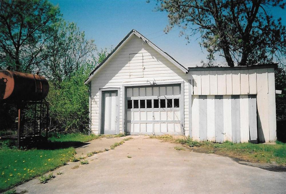 Barg Homestead garage with gas tank.