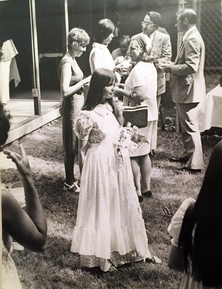 Camy in her blue calico wedding dress that she made herself, during the backyard reception. June 2, 1973.