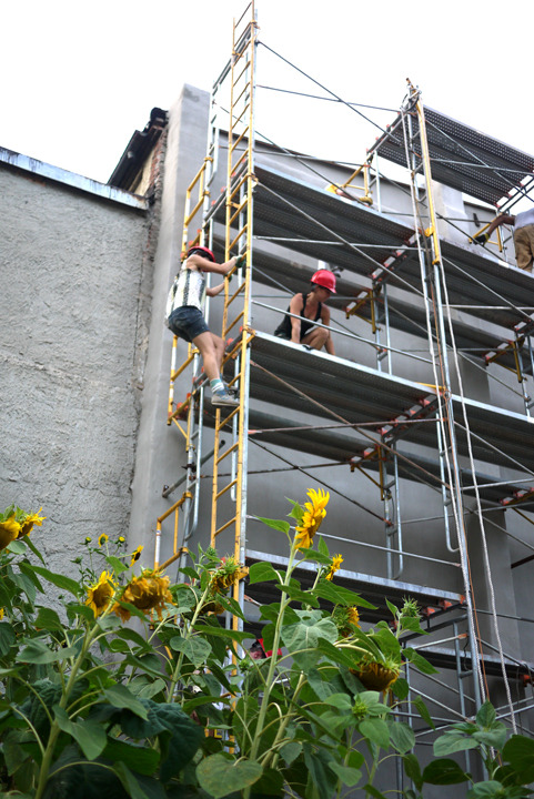 Scaffolding was used to install the murals