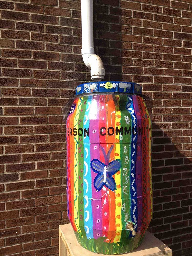 A colorful rain barrel