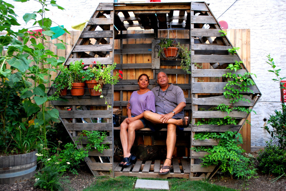 """Honeycomb Hideout,"" a hexagonal wooden abode by Peter Abrams, provides the garden with a cool and cozy place to sit."