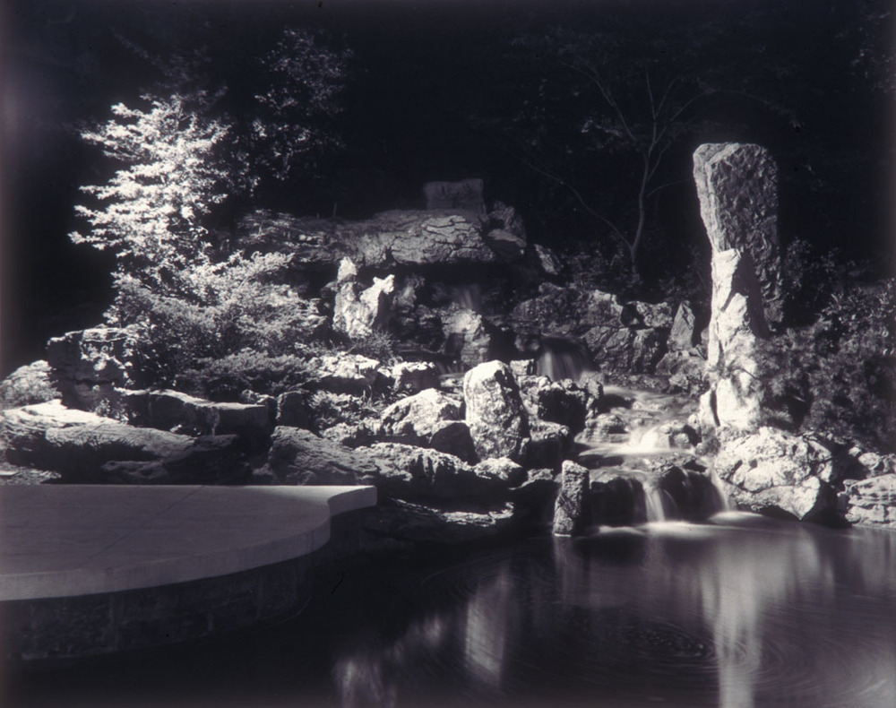 The Capitol Car Distributors garden pond illuminated at night. Stewart Brothers, photographers, circa 1966. Smithsonian Institution, Archives of American Gardens, Garden Club of America Collection.