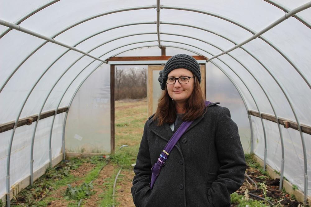 Christina in a greenhouse