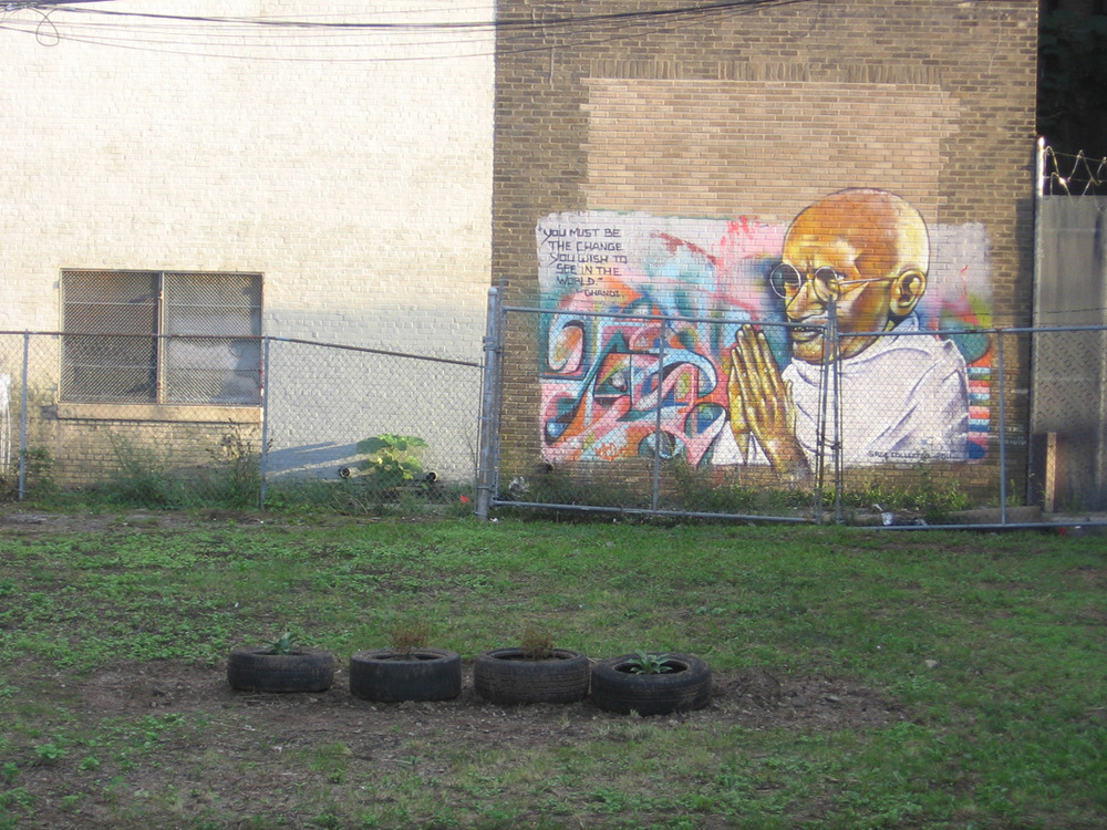 After they finished clearing out the lot, they discovered a mural of Mahatma Gandhi, as well as hundreds of discarded tires.