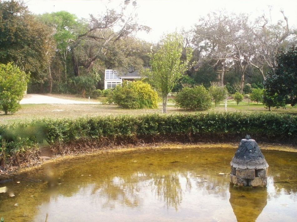 The remains of the sunken pool and fountain, with the remodeled greenhouse in background, 2009. Marianne Salas, photographer. Smithsonian Institution, Archives of American Gardens, Garden Club of America Collection.