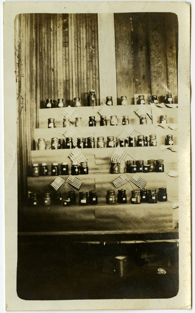 The Food Club's prize-winning canning displays at a fair, circa 1924