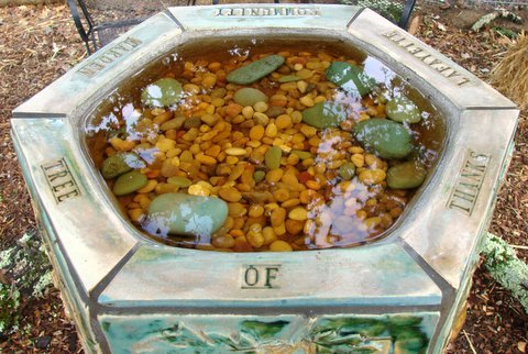 A tiled birdbath recognizing donors
