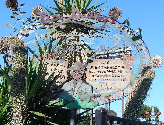 A whimsical entry sign features the namesake of Big Daddy's Complete Rejuvenating Community Garden.