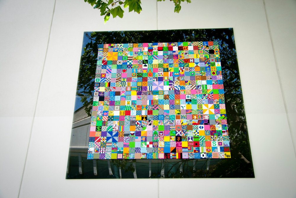 The six-foot-tall <em>Beaded Quilt</em> is installed on the wall of The LightHouse, and highlights the entrance to the Please Touch Community Garden. Photo by Gk Callahan, 2011.