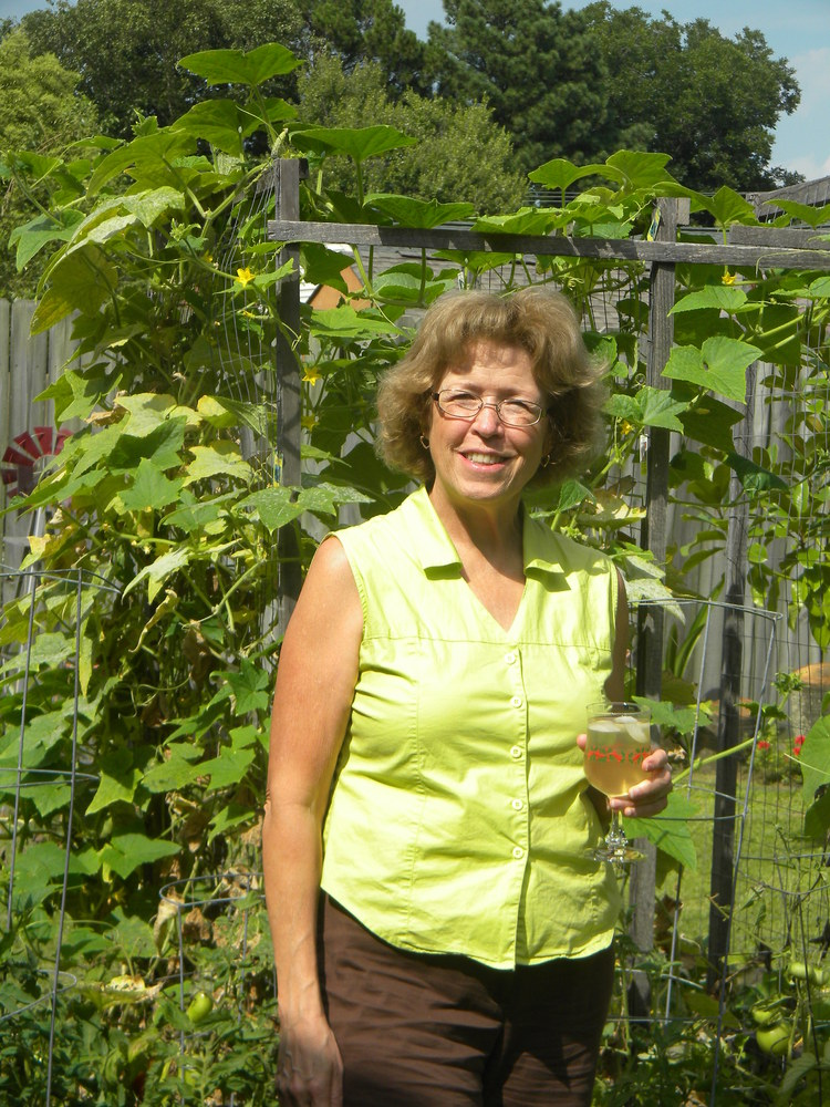 Susan, the author, in her Virginia Beach garden.