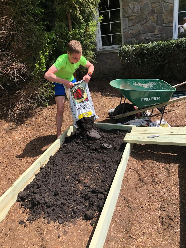 Adding soil to the beds