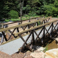One of the eight new bridges designed and constructed by Clemson University students in the South Carolina Botanical Garden. The bridges are constructed of fiberglass, concrete, and steel.