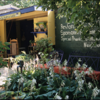 """La Casita"" (the little house"") at Las Parcelas community garden is reminiscent of housing in pre-WWII Puerto Rico. It is used as an educational space within the garden. Ann Reed, photographer, 2007. Smithsonian Institution, Archives of American Gardens, Garden Club of America Collection."
