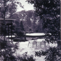 Free-form pond and patio in the gardens of Capitol Car Distributors in Lanham, Maryland. Stewart Brothers, photographers, circa 1966. Smithsonian Institution, Archives of American Gardens, Garden Club of America Collection.
