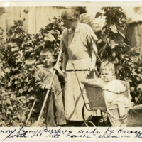 """Beans grown from Burpee's seeds by Horace and Jack O'Donnell with the two 'bosses' shown in the picture."" Francis O'Donnell and her children in their garden in Mountain Lake Park, Maryland, circa 1924. Smithsonian Institution, Archives of American Gardens, W. Atlee Burpee & Company Records."