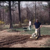 The author's parents tilling their garden