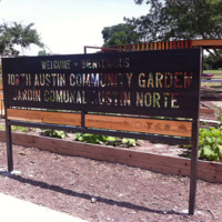 A welcome sign greets visitors to the North Austin Community Garden. © Art in Public Places Program, 2014