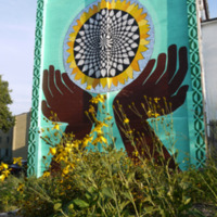 The design on the south wall takes a more abstract approach to the sunflower theme, which an also be seen in the sunflower mountain.